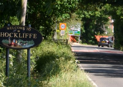 Hockliffe Village Sign at the side of the road