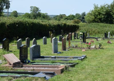 Line of gravestones at Hockliffe Cemetery